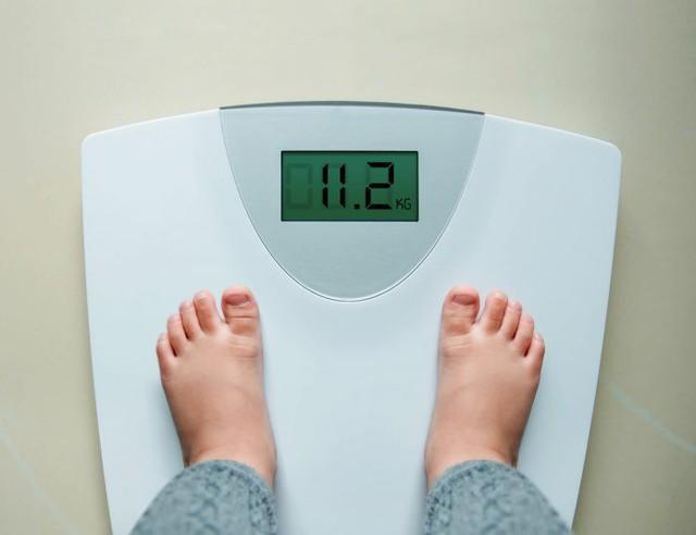 Làm gì để giúp con giảm cân? - Ảnh 1.